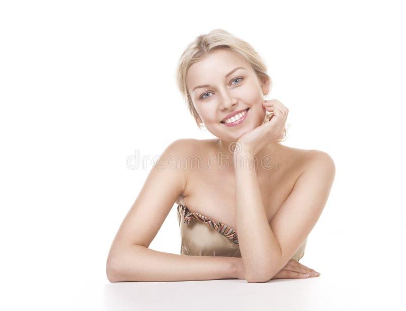 微笑的妇女白肤金发在白色 库存图片