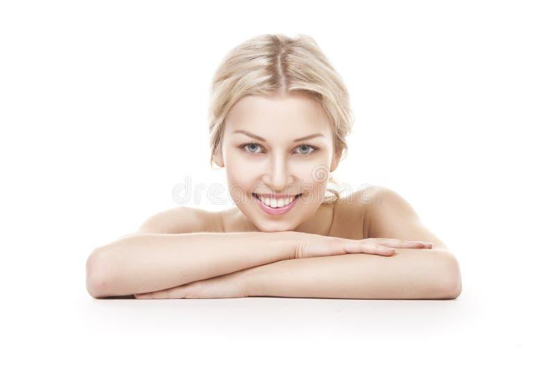 微笑的妇女白肤金发在白色 库存照片