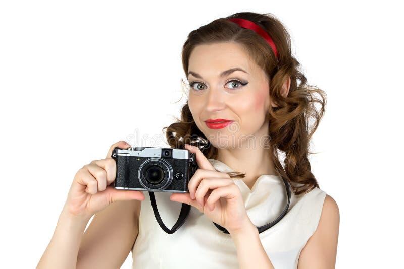 微笑的妇女的照片有照相机的 免版税库存图片