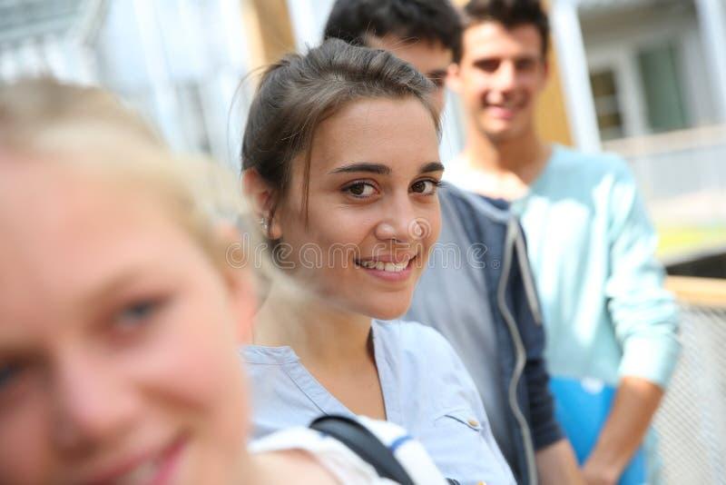 微笑的学生女孩 库存图片