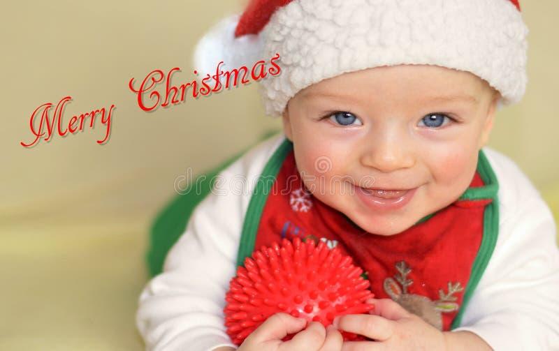 微笑的小孩祝愿圣诞快乐 库存照片