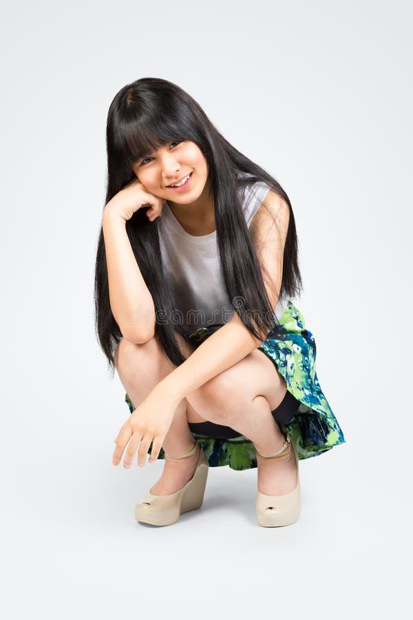 微笑的少年亚洲女孩开会 免版税库存图片