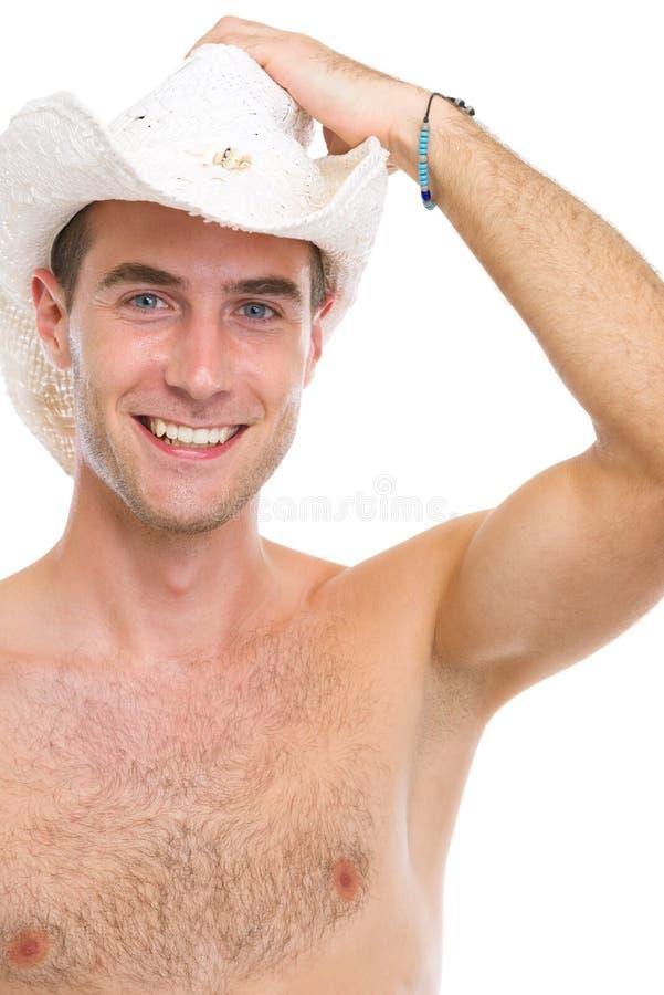 微笑的年轻人纵向帽子的 库存图片