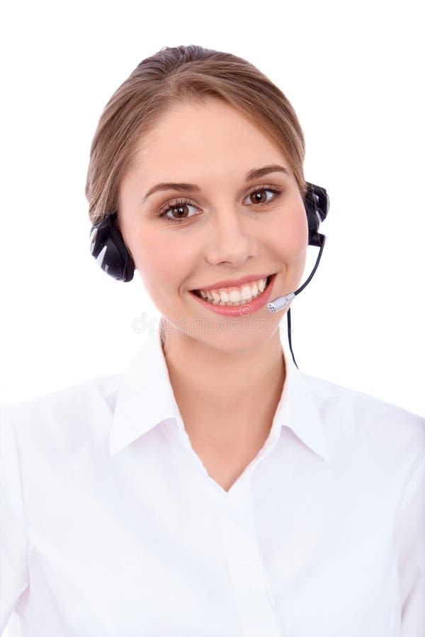 微笑的快乐的年轻人画象支持耳机的电话操作员,被隔绝在白色背景 图库摄影