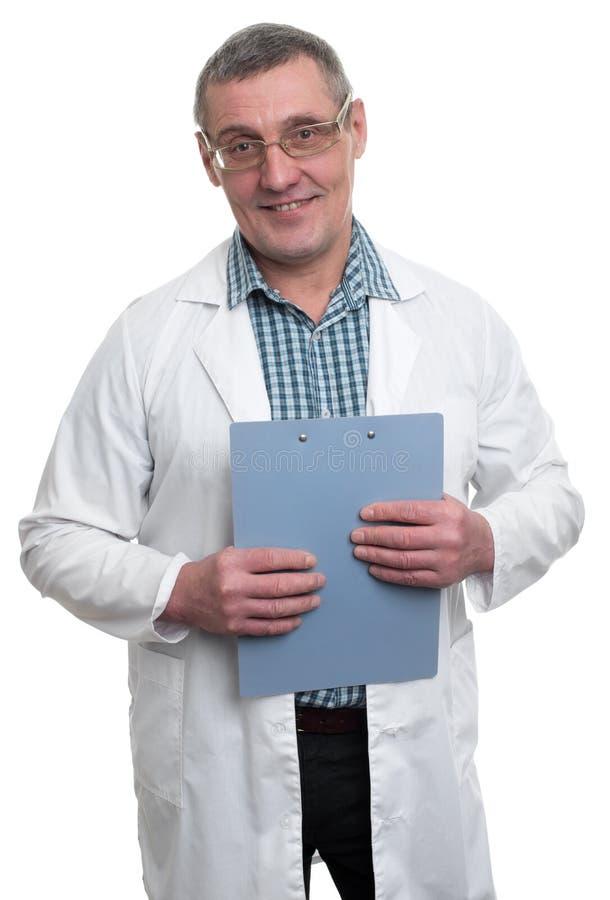 微笑的成熟医生画象 免版税库存图片