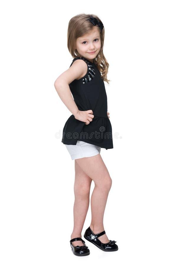 微笑的时尚小女孩站立 图库摄影