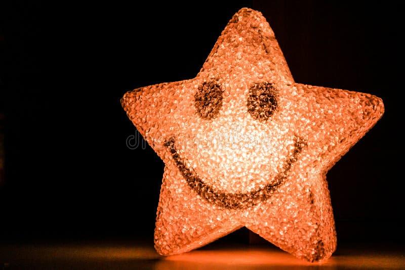 微笑的星发光 免版税库存照片