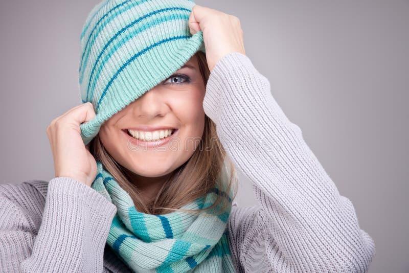 微笑的滑稽的冬天女孩 图库摄影