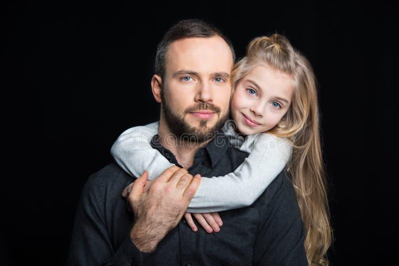 微笑的父亲和女儿 免版税库存照片