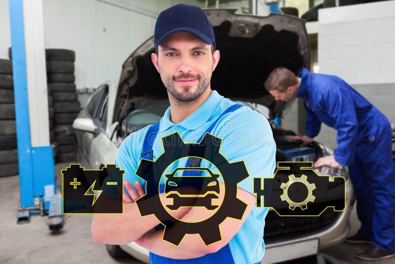 微笑的男性杂物工的综合图象站立胳膊的工作服的横渡 库存图片
