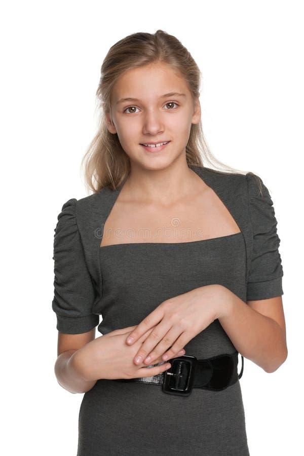 微笑的白肤金发的青少年的女孩 图库摄影