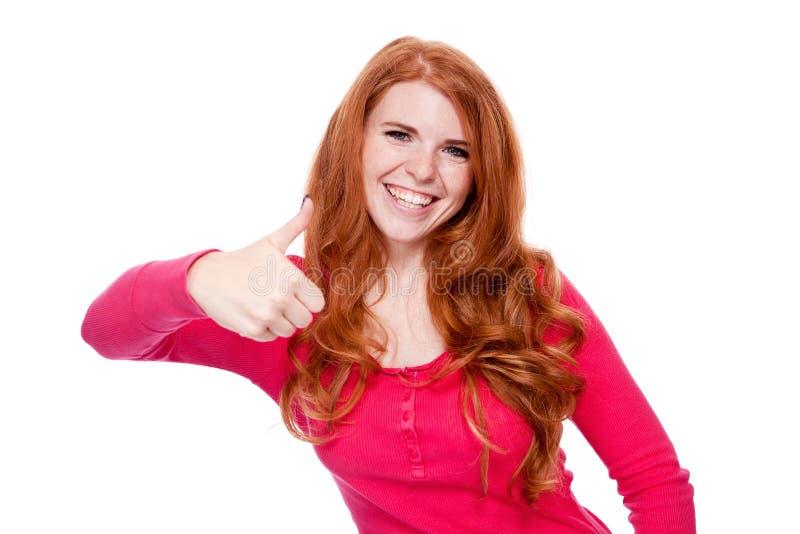 年轻微笑的红头发人妇女画象被隔绝的表示 库存图片