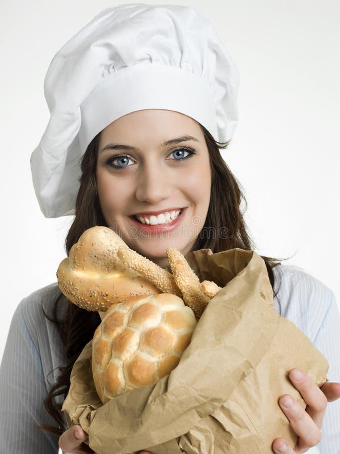 微笑的厨师用意大利面包 图库摄影
