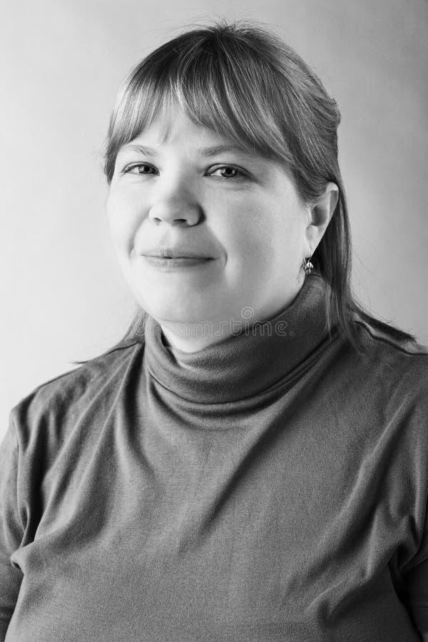 微笑的肥胖妇女 图库摄影