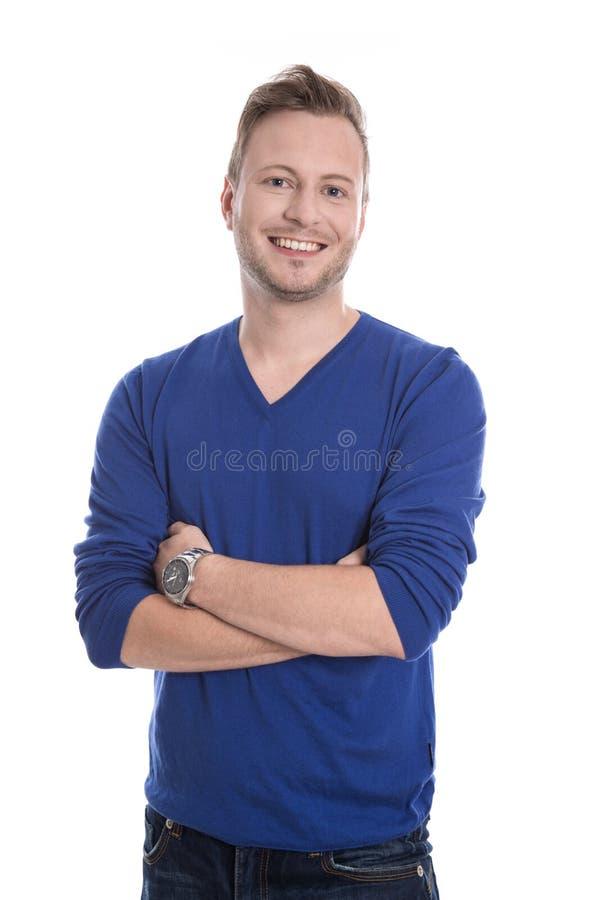 微笑的年轻人;在白色隔绝的蓝色套头衫。 库存照片