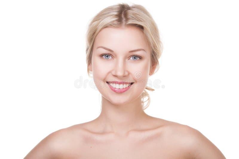 微笑的年轻白肤金发的妇女 库存图片