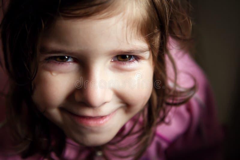微笑通过泪花 免版税库存图片