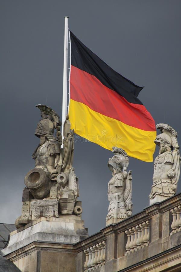 德国标志在黑暗的天空下 库存图片
