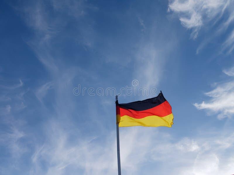 德国飞行旗子在风的 免版税库存照片