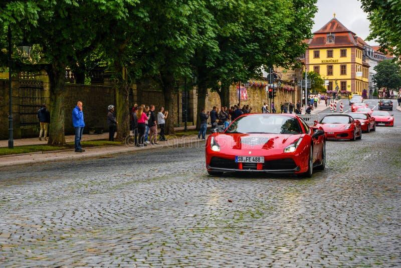 德国,富尔达- 2019年7月:红色法拉利488小轿车类型F142M是意大利汽车生产的中间引擎跑车 免版税库存照片