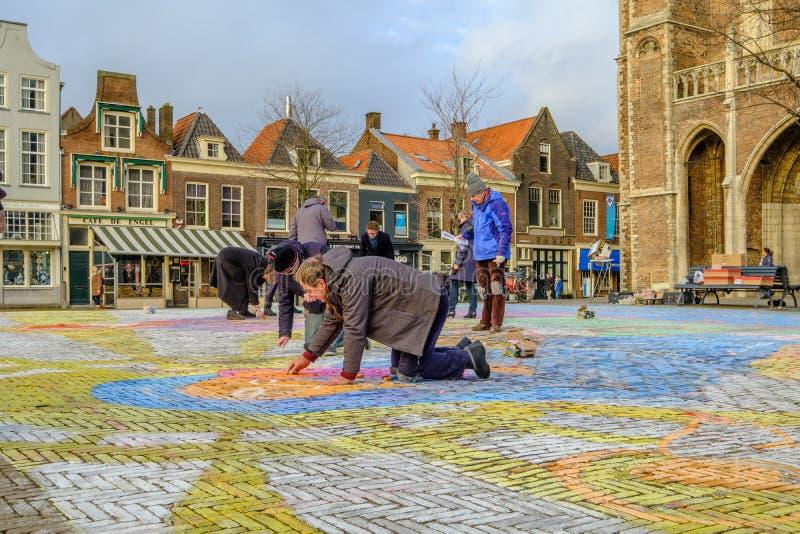 德尔福特,荷兰- DEC 19日2017年:创造在街道上的人们绘画在德尔福特,荷兰 免版税库存照片