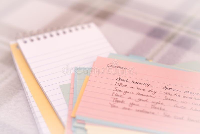 德语;学会在笔记本的新的语言文字问候 库存图片