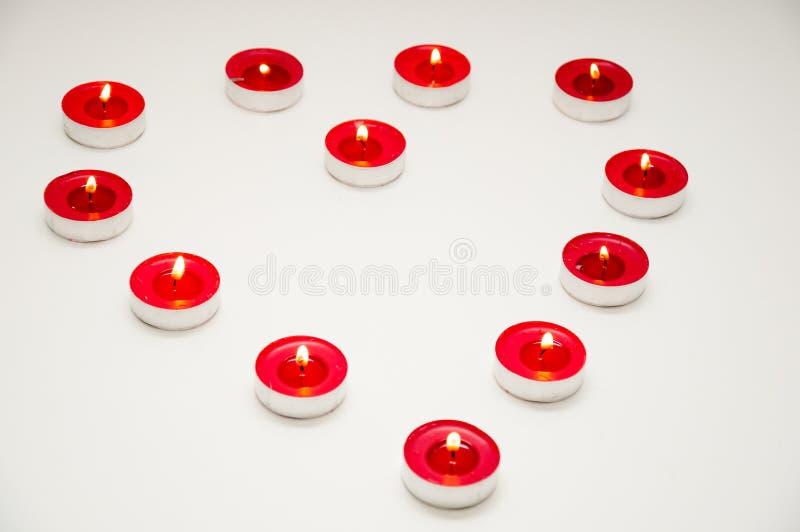 心脏做了蜡烛在空白的背景 免版税图库摄影