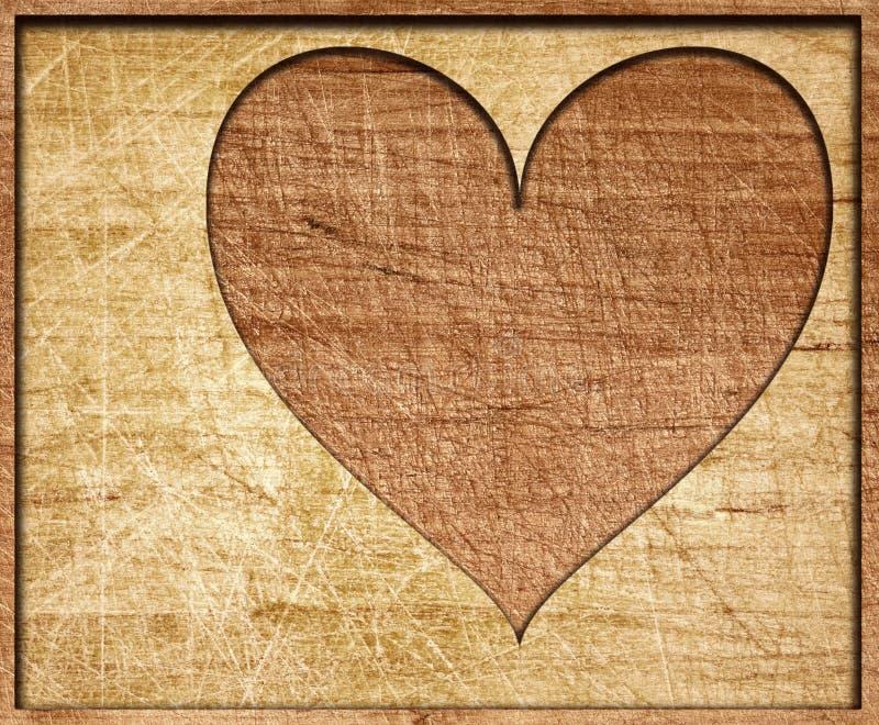 心脏形状在有框架的木板切开了 图库摄影