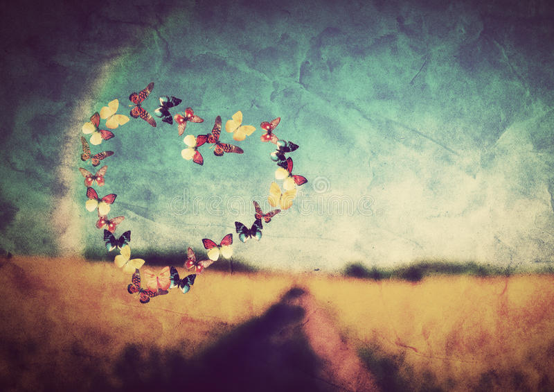 心脏形状由五颜六色的蝴蝶做成 免版税库存照片