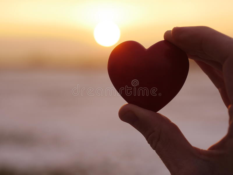 心脏日落爱 库存图片