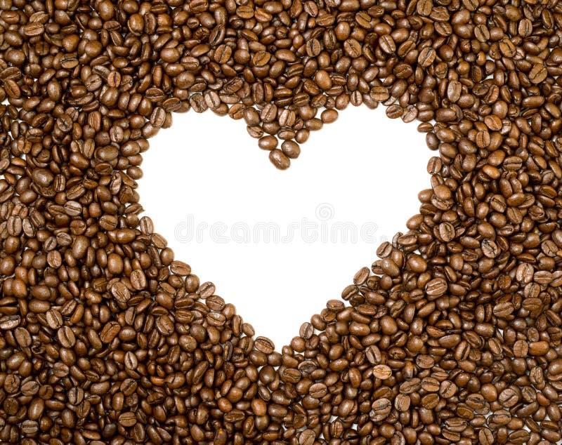 心脏框架背景由咖啡豆制成 图库摄影