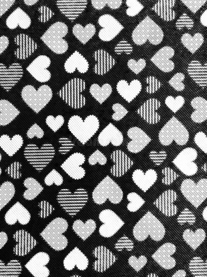 心脏爱白色黑墙壁 免版税库存照片