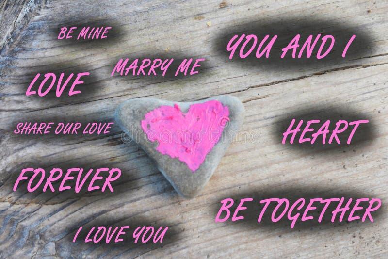 心脏绘与在石头片断的唇膏  免版税库存照片