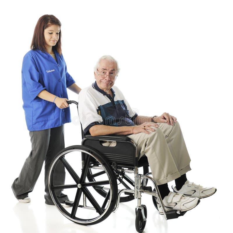 志愿与老人一起使用 图库摄影