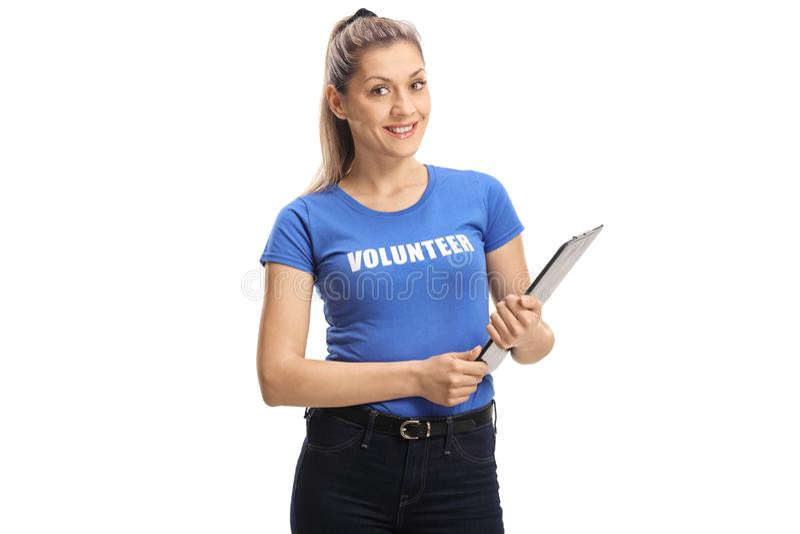 志愿和拿着剪贴板的年轻女人 库存照片
