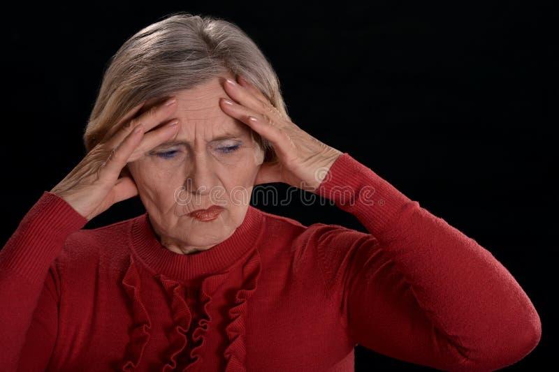 忧郁年长妇女 库存图片