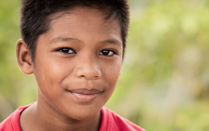 快乐年轻马来西亚男孩微笑 免版税库存照片