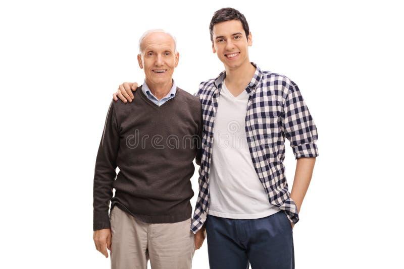 快乐的一起摆在父亲和的儿子 免版税图库摄影
