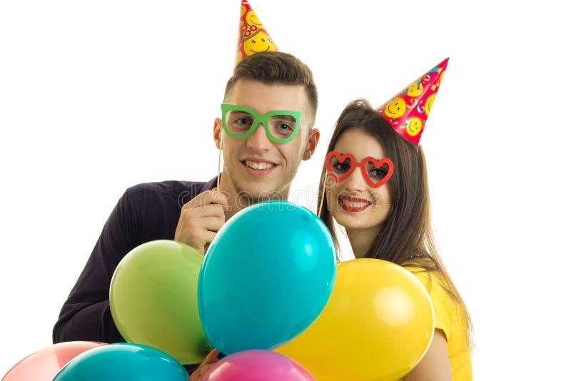 快乐的人和女孩特写镜头画象玻璃和气球的 免版税库存图片