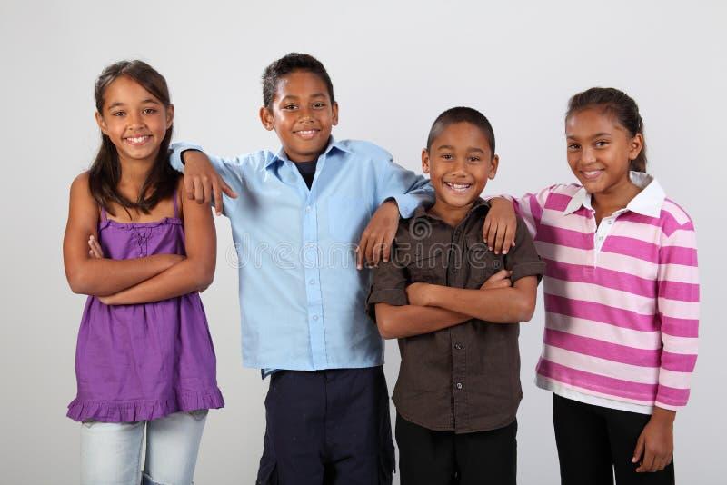 快乐的四个朋友时候照片学校共用 免版税库存照片