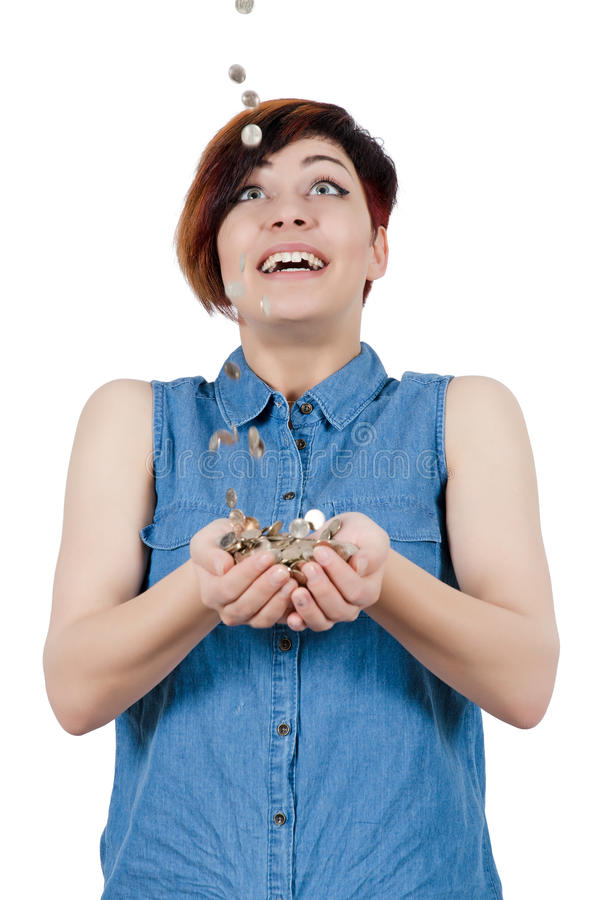 快乐的女孩投入了您的手在硬币下雨  免版税库存照片