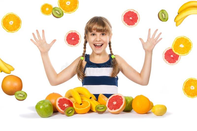 快乐的女孩用果子 库存图片