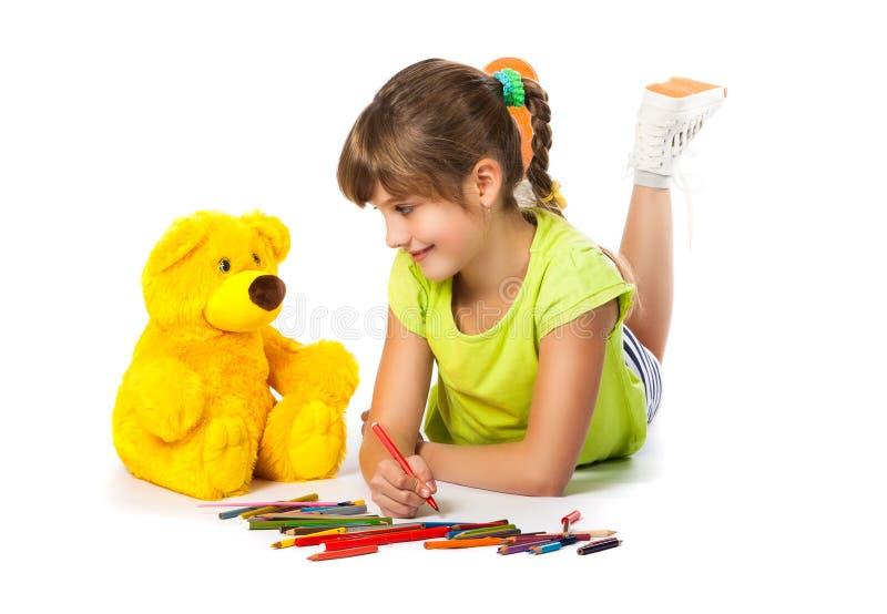 快乐的女孩画铅笔 库存照片