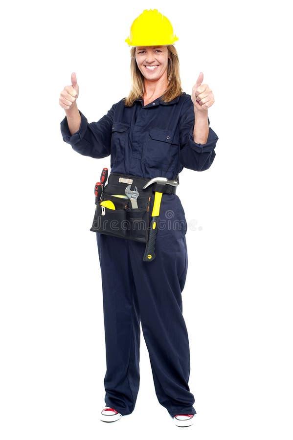 快乐的女性建筑师闪动的双赞许 库存照片