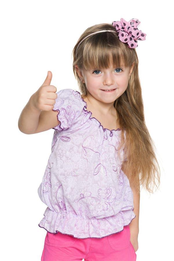 快乐的小女孩举行她的赞许 免版税库存照片