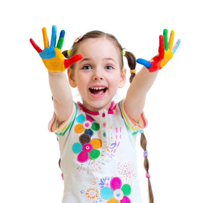 快乐的小女孩用在油漆的手在白色 库存照片
