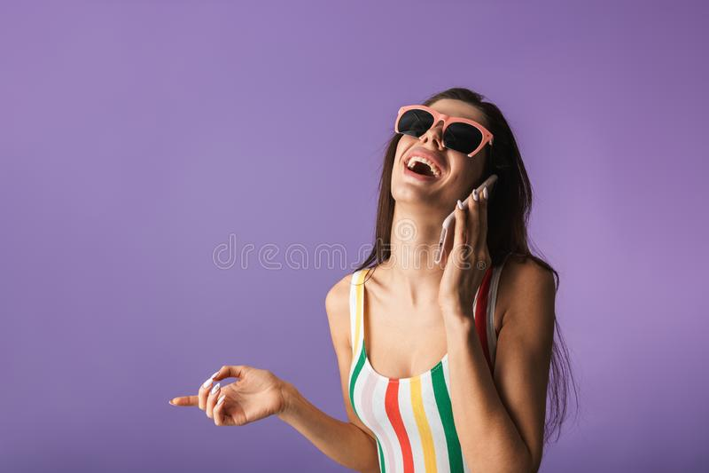 快乐的少女佩带的泳装身分 库存图片