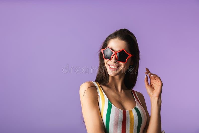 快乐的少女佩带的泳装身分 库存照片