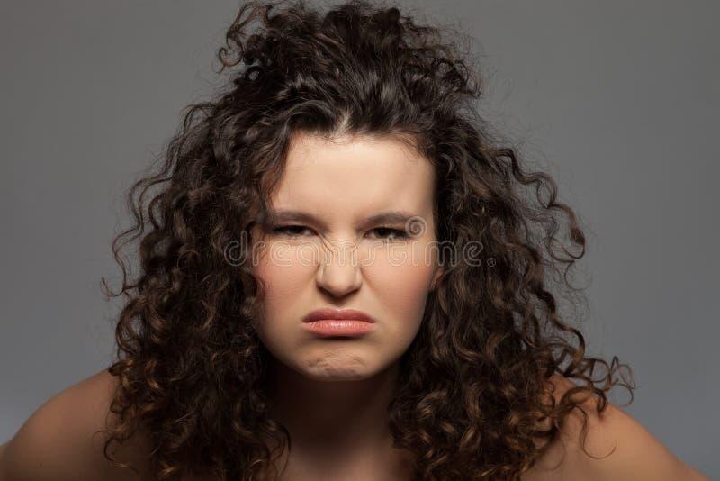 快乐的少妇表现出消极情感 免版税库存照片