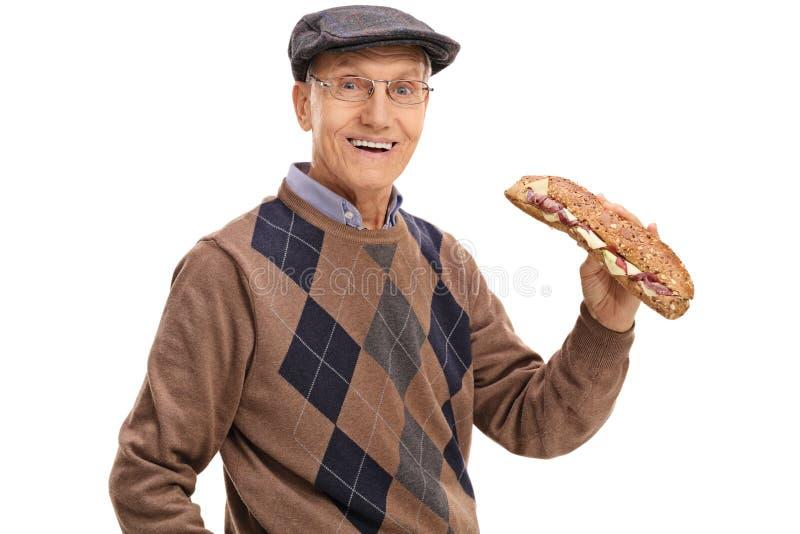 快乐的成熟人用三明治 免版税图库摄影